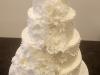 witte_bruidstaart_heel_veel_bloemen